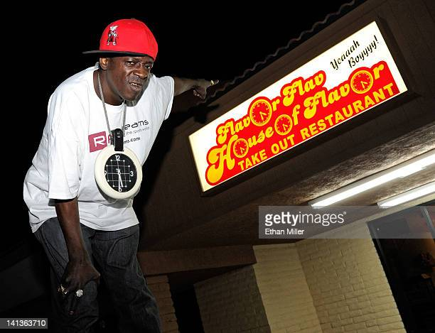 Rapper Flavor Flav poses outside his Flavor Flav House of Flavor Take Out Restaurant on March 14 2012 in Las Vegas Nevada Flav is holding the...