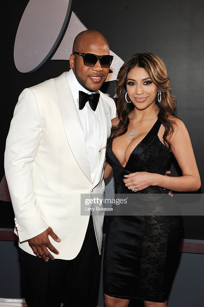 Rapper <a gi-track='captionPersonalityLinkClicked' href=/galleries/search?phrase=Flo+Rida&family=editorial&specificpeople=4456012 ng-click='$event.stopPropagation()'>Flo Rida</a> and guest arrive at the 54th Annual GRAMMY Awards held at Staples Center on February 12, 2012 in Los Angeles, California.