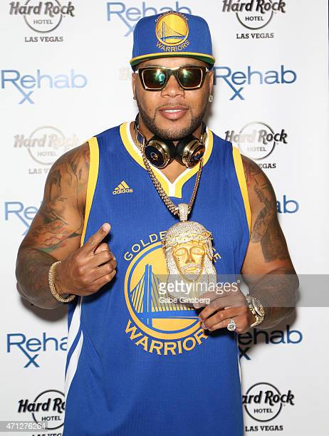 Rapper Flo Rida arrives at the Hard Rock Hotel Casino during the resort's Rehab pool grand opening weekend on April 26 2015 in Las Vegas Nevada