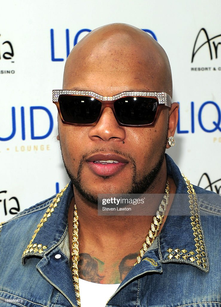 Rapper Flo Rida arrives at the Liquid Pool Lounge at the Aria Resort & Casino at CityCenter for Memorial Day weekend on May 27, 2013 in Las Vegas, Nevada.