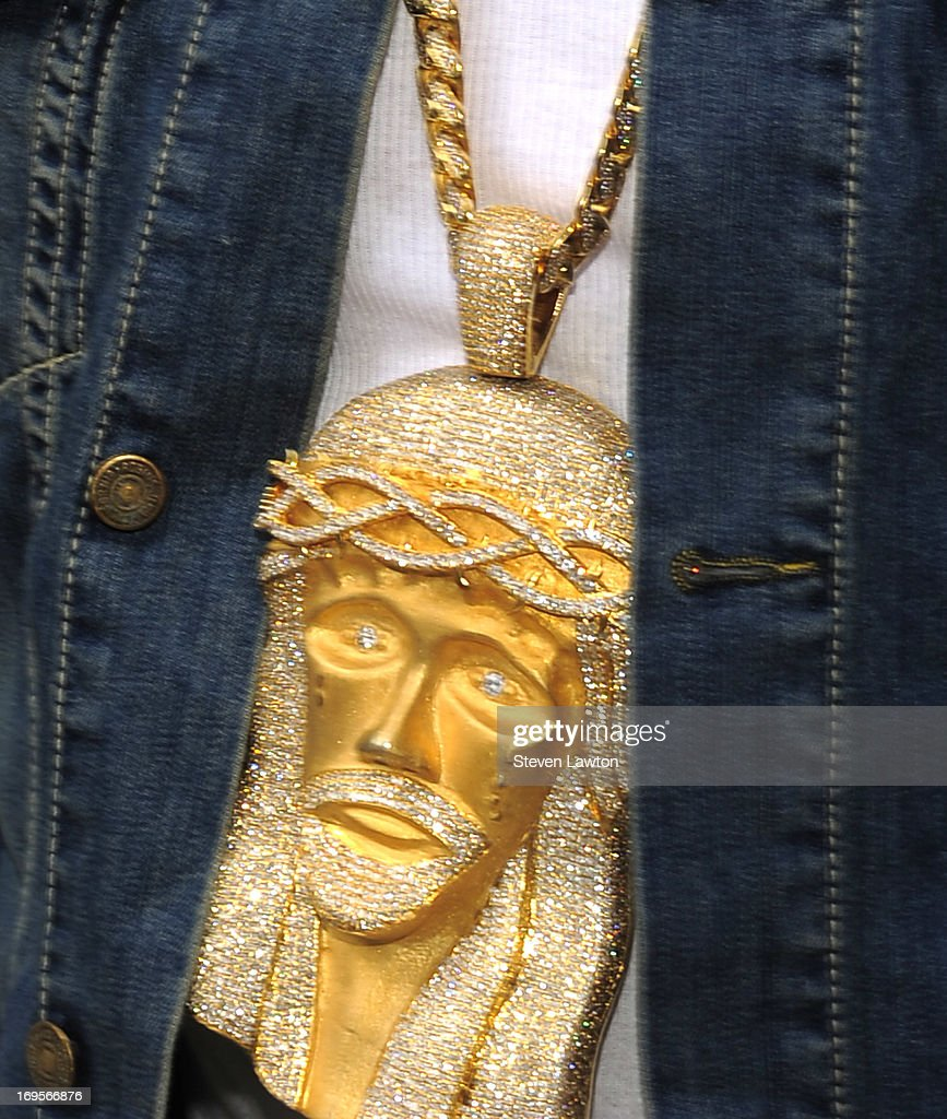 Rapper <a gi-track='captionPersonalityLinkClicked' href=/galleries/search?phrase=Flo+Rida&family=editorial&specificpeople=4456012 ng-click='$event.stopPropagation()'>Flo Rida</a> (necklace charm detail) arrives at the Liquid Pool Lounge at the Aria Resort & Casino at CityCenter for Memorial Day weekend on May 27, 2013 in Las Vegas, Nevada.