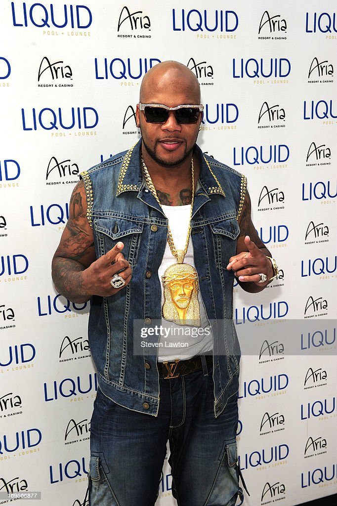 Rapper <a gi-track='captionPersonalityLinkClicked' href=/galleries/search?phrase=Flo+Rida&family=editorial&specificpeople=4456012 ng-click='$event.stopPropagation()'>Flo Rida</a> arrives at the Liquid Pool Lounge at the Aria Resort & Casino at CityCenter for Memorial Day weekend on May 27, 2013 in Las Vegas, Nevada.