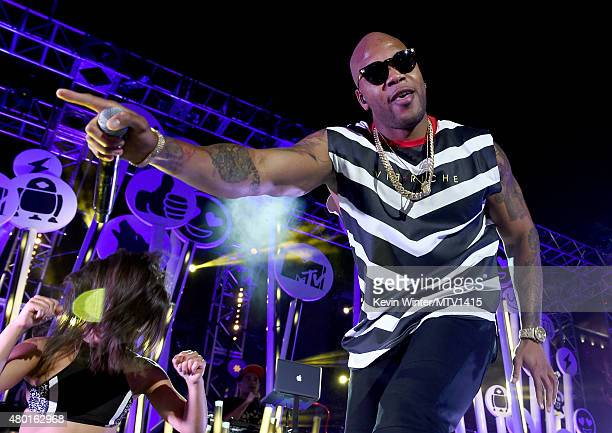 Rapper Flo Rida performs onstage during the MTV Fandom Fest San Diego ComicCon at PETCO Park on July 9 2015 in San Diego California