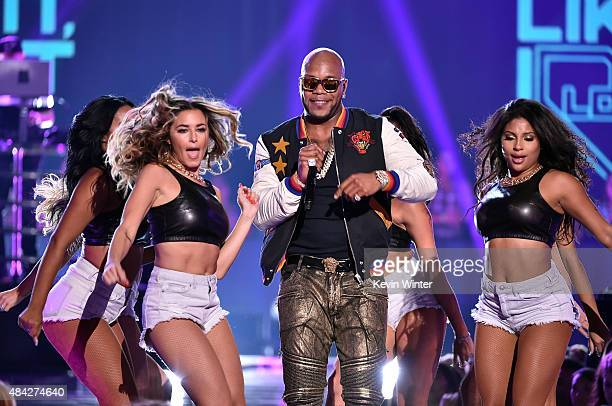 Rapper Flo Rida performs onstage during the Teen Choice Awards 2015 at the USC Galen Center on August 16 2015 in Los Angeles California