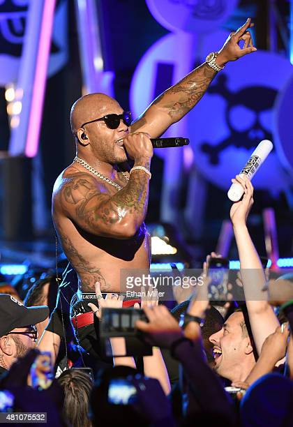 Rapper Flo Rida surfs the crowd as he performs during the MTV Fandom Fest San Diego ComicCon at PETCO Park on July 9 2015 in San Diego California