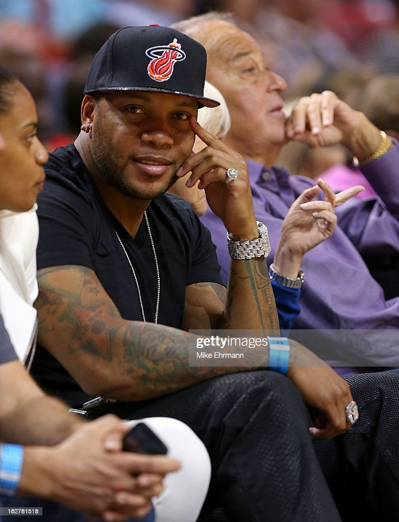 Rapper Flo Rida watches a game between the Miami Heat and the Sacramento Kings at American Airlines Arena on February 26, 2013 in Miami, Florida.