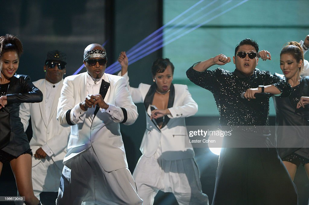 Rapper Hammer (L) and singer Psy perform onstage during the 40th Anniversary American Music Awards held at Nokia Theatre L.A. Live on November 18, 2012 in Los Angeles, California.