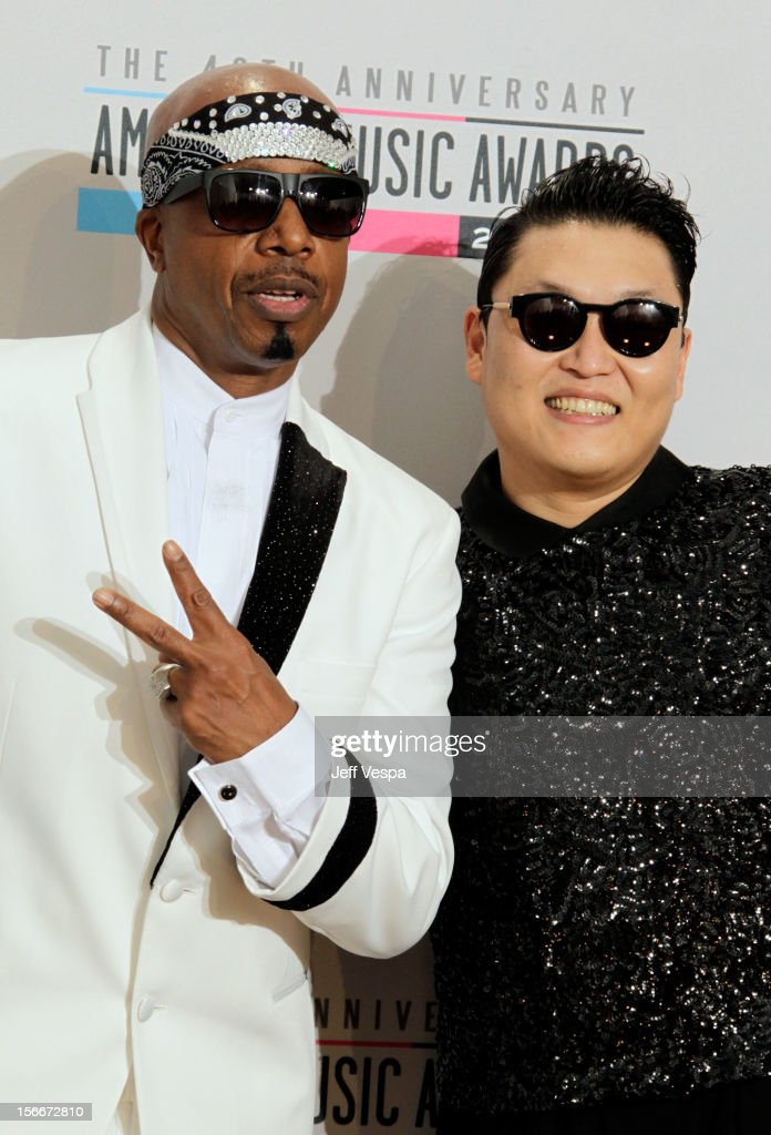 Rapper Hammer (L) and singer Psy pose in the press room at the 40th Anniversary American Music Awards held at Nokia Theatre L.A. Live on November 18, 2012 in Los Angeles, California.