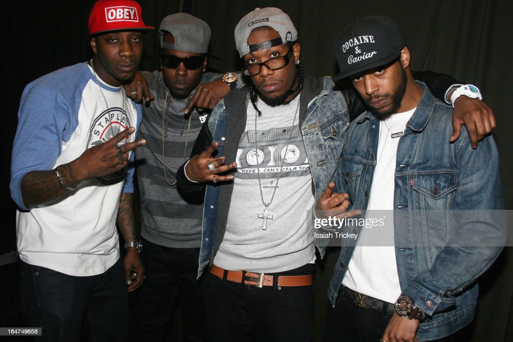 Rapper Hype (3rd from L) and crew attend the On The Radar showcase during Canadian Music Week at the Wreck Room on March 24, 2013 in Toronto, Canada.