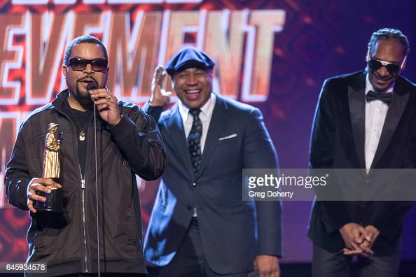 Rapper Ice Cube receives an award from Rappers LL Cool J and Snoop Dog at the 2nd Annual All Def Movie Awards at Belasco Theatre on February 22 2017...