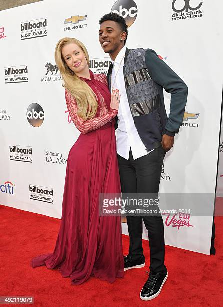 Rapper Iggy Azalea and basketball player Nick Young attend the 2014 Billboard Music Awards at the MGM Grand Garden Arena on May 18 2014 in Las Vegas...