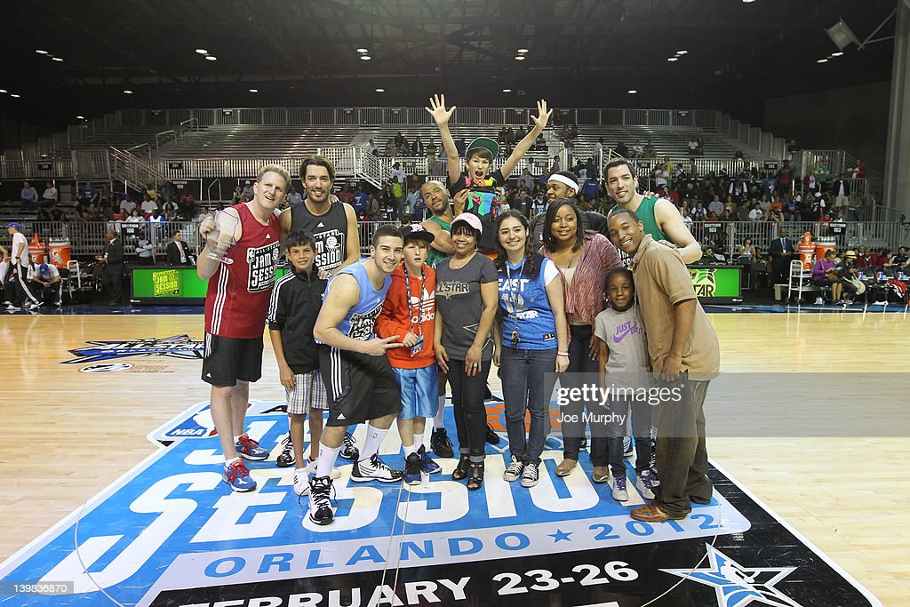 Rapper J. Cole, Actors Drew and Jonathan Scott, Actor Michael Rapaport, Actor Jesse Williams and Reality TV celebrity Vinny Guadagnino pose for a photo during the Celebrity 3-Point Contest on center court at Jam Session during the NBA All-Star Weekend on February 25, 2012 at the Orange County Convention Center in Orlando, Florida.