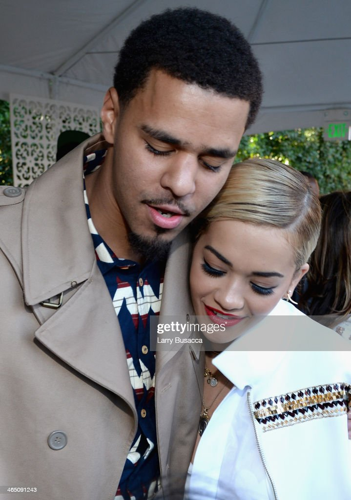Rapper <a gi-track='captionPersonalityLinkClicked' href=/galleries/search?phrase=J.+Cole&family=editorial&specificpeople=5958978 ng-click='$event.stopPropagation()'>J. Cole</a> (L) and singer/songwriter <a gi-track='captionPersonalityLinkClicked' href=/galleries/search?phrase=Rita+Ora&family=editorial&specificpeople=5686485 ng-click='$event.stopPropagation()'>Rita Ora</a> attend the Roc Nation Pre-GRAMMY Brunch Presented by MAC Viva Glam at Private Residence on January 25, 2014 in Beverly Hills, California.