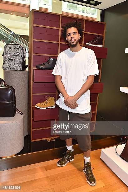 Rapper J Cole attends J Cole For Bally Cocktail at Bally Phipps Plaza on August 15 2015 in Atlanta Georgia