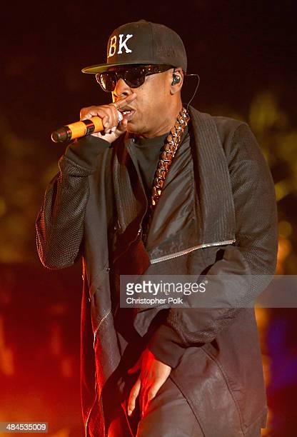 Rapper Jay Z performs onstage during day 2 of the 2014 Coachella Valley Music Arts Festival at the Empire Polo Club on April 12 2014 in Indio...