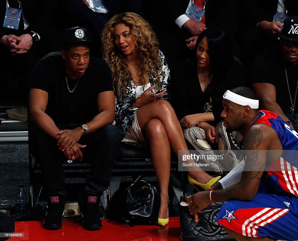 Rapper Jay-Z and Beyonce look over at LeBron James #6 of the Miami Heat and the Eastern Conference during the 2013 NBA All-Star game at the Toyota Center on February 17, 2013 in Houston, Texas.
