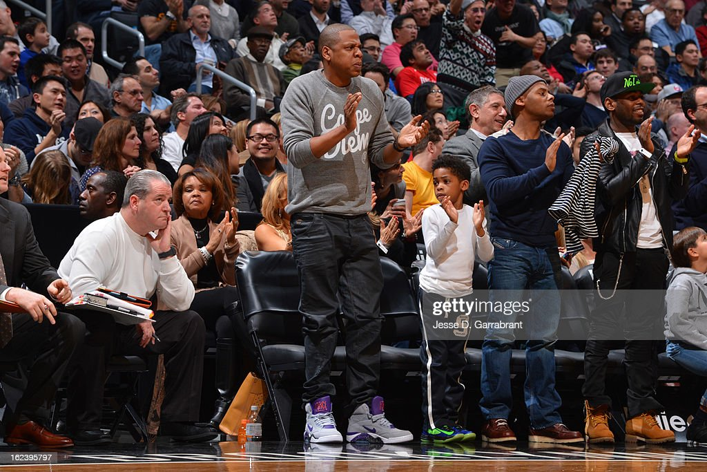 Rapper <a gi-track='captionPersonalityLinkClicked' href=/galleries/search?phrase=Jay-Z&family=editorial&specificpeople=201664 ng-click='$event.stopPropagation()'>Jay-Z</a> applauded during the game between the Houston Rockets and the Brooklyn Nets at the Barclays Center on February 22, 2013 in Brooklyn, New York.