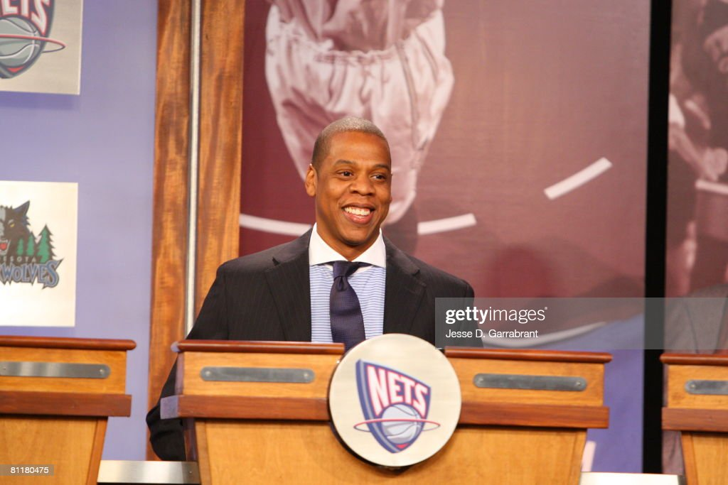 Rapper <a gi-track='captionPersonalityLinkClicked' href=/galleries/search?phrase=Jay-Z&family=editorial&specificpeople=201664 ng-click='$event.stopPropagation()'>Jay-Z</a>, investor and minority owner of the New Jersey Nets, smiles after receiving the 10th pick during the 2008 NBA Draft Lottery at the NBATV Studios May 20, 2008 in Secaucus, New Jersey.