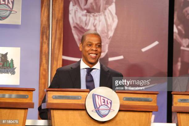Rapper JayZ investor and minority owner of the New Jersey Nets smiles after receiving the 10th pick during the 2008 NBA Draft Lottery at the NBATV...