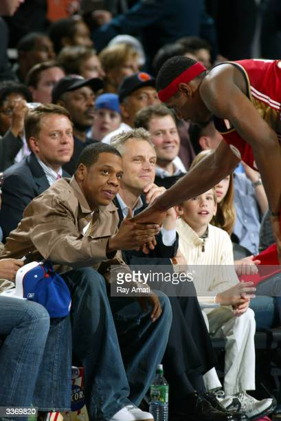 Rapper JayZ meets the Cavalier's Lebron James during New York Knicks v Cleveland Cavaliers game at Madison Square Garden on April 14 2004 in New York...