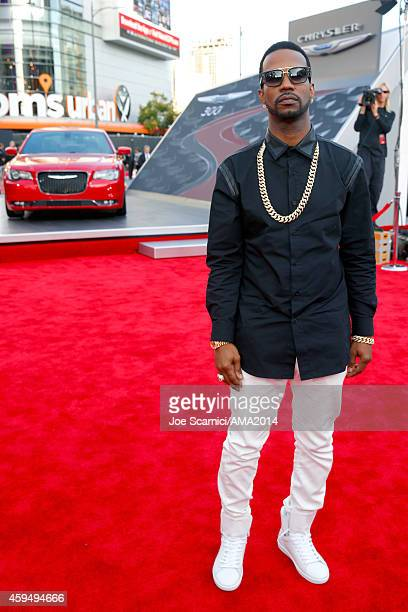 Rapper Juicy J attends the 2014 American Music Awards red carpet arrivals featuring the AllNew Chrysler 300S at Nokia Theatre LA Live on November 23...