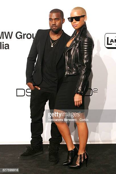 Rapper Kanye West and guest on the AmfAR Milano 2009 red carpet during the inaugural Milan Fashion Week event at La Permanente