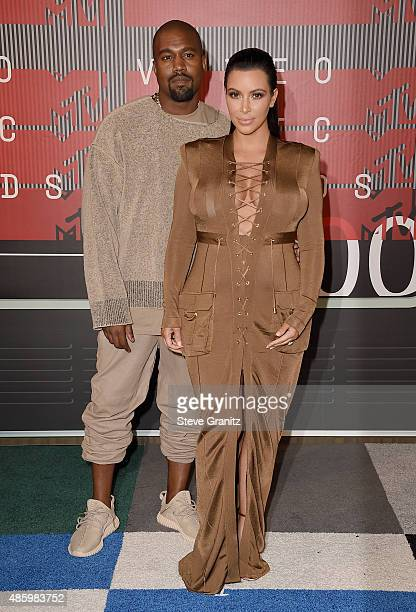 Rapper Kanye West and TV personality Kim Kardashian attend the 2015 MTV Video Music Awards at Microsoft Theater on August 30 2015 in Los Angeles...