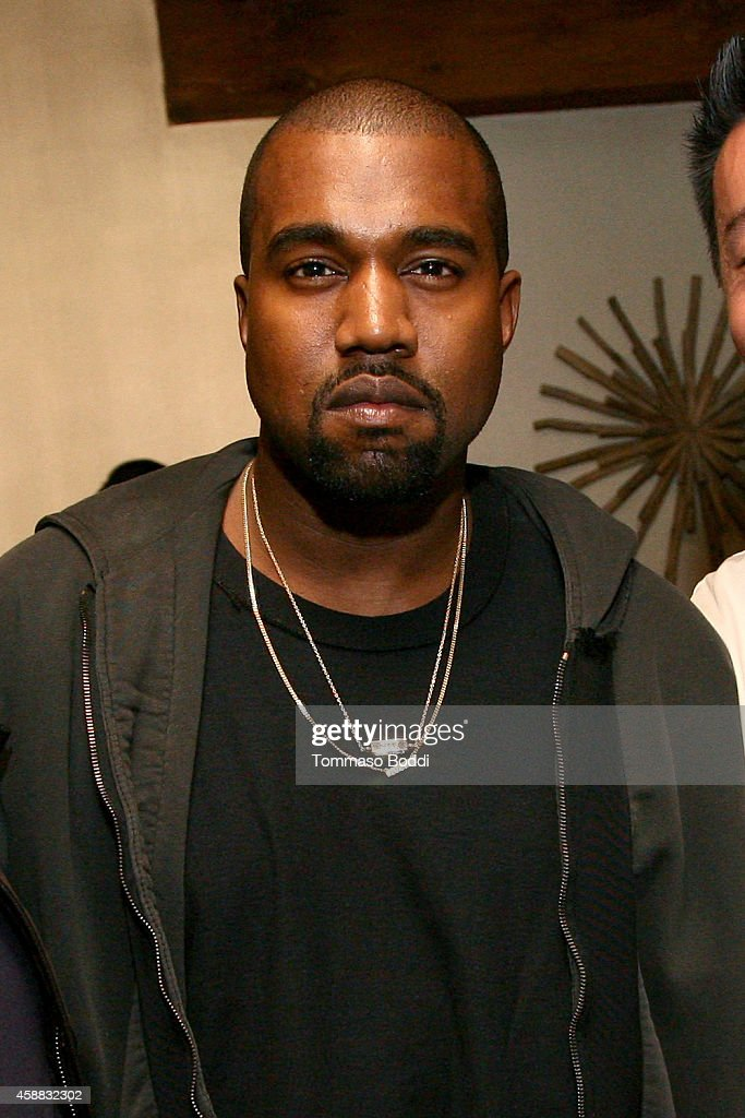 Rapper Kanye West attends DuJour Magazine's Jason Binn Welcomes Yellowtail Sunset's Chef Akira Back to LA at Yellowtail Sunset on November 11 2014 in...
