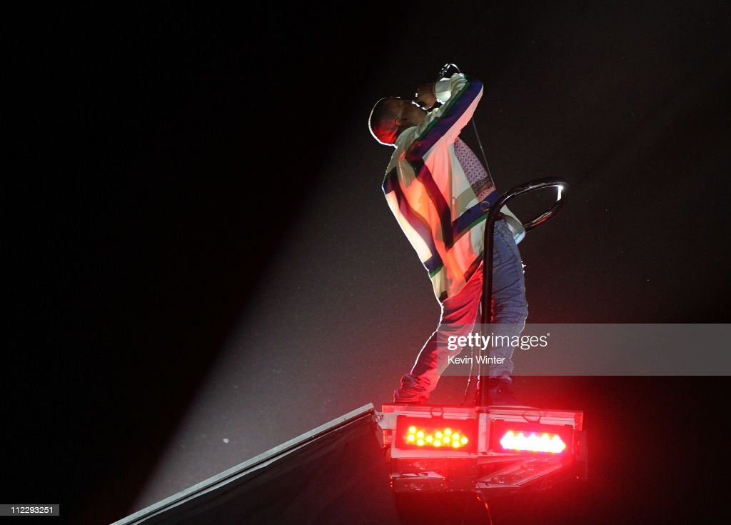 Rapper <a gi-track='captionPersonalityLinkClicked' href=/galleries/search?phrase=Kanye+West+-+Musician&family=editorial&specificpeople=201803 ng-click='$event.stopPropagation()'>Kanye West</a> performs during Day 3 of the Coachella Valley Music & Arts Festival 2011 held at the Empire Polo Club on April 17, 2011 in Indio, California.
