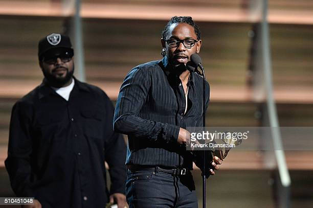 Rapper Kendrick Lamar accepts the award for Best Rap Album for 'To Pimp a Butterfly' from rapper Ice Cube onstage during The 58th GRAMMY Awards at...