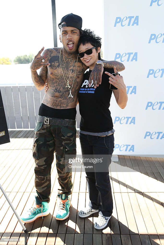 Rapper Kid Ink (L) and PETA associate director of communications Michelle Cho attends the unveiling of Kid Ink's 'Ink, Not Mink' anti-fur ad for PETA at The Bob Barker Building on March 11, 2013 in Los Angeles, California.