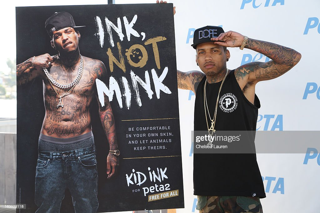 Rapper <a gi-track='captionPersonalityLinkClicked' href=/galleries/search?phrase=Kid+Ink+-+Rapper&family=editorial&specificpeople=8191530 ng-click='$event.stopPropagation()'>Kid Ink</a> attends the unveiling of his 'Ink, Not Mink' anti-fur ad for PETA at The Bob Barker Building on March 11, 2013 in Los Angeles, California.