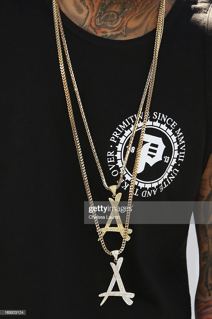 Rapper <a gi-track='captionPersonalityLinkClicked' href=/galleries/search?phrase=Kid+Ink+-+Rapper&family=editorial&specificpeople=8191530 ng-click='$event.stopPropagation()'>Kid Ink</a> (necklace detail) attends the unveiling of his 'Ink, Not Mink' anti-fur ad for PETA at The Bob Barker Building on March 11, 2013 in Los Angeles, California.