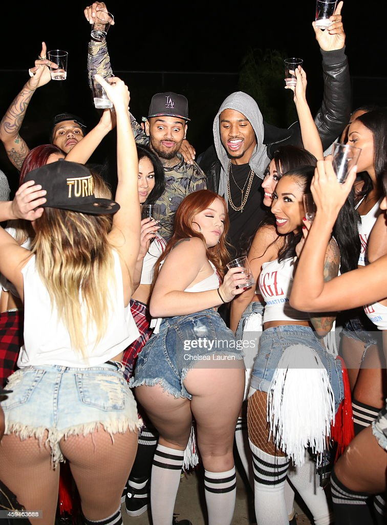 Rapper Kid Ink singers Chris Brown and Trey Songz attend Trey Songz' 30th birthday carnival extravaganza on November 22 2014 in Agoura Hills...