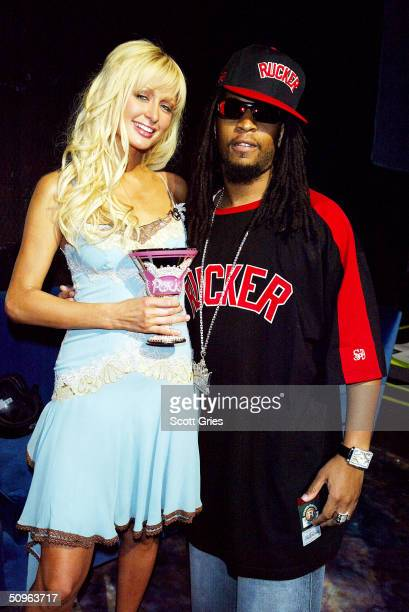 Rapper Lil Jon and socialite/actress Paris Hilton pose for a photo backstage during MTV's Total Request Live at the MTV Times Square Studios June 15...