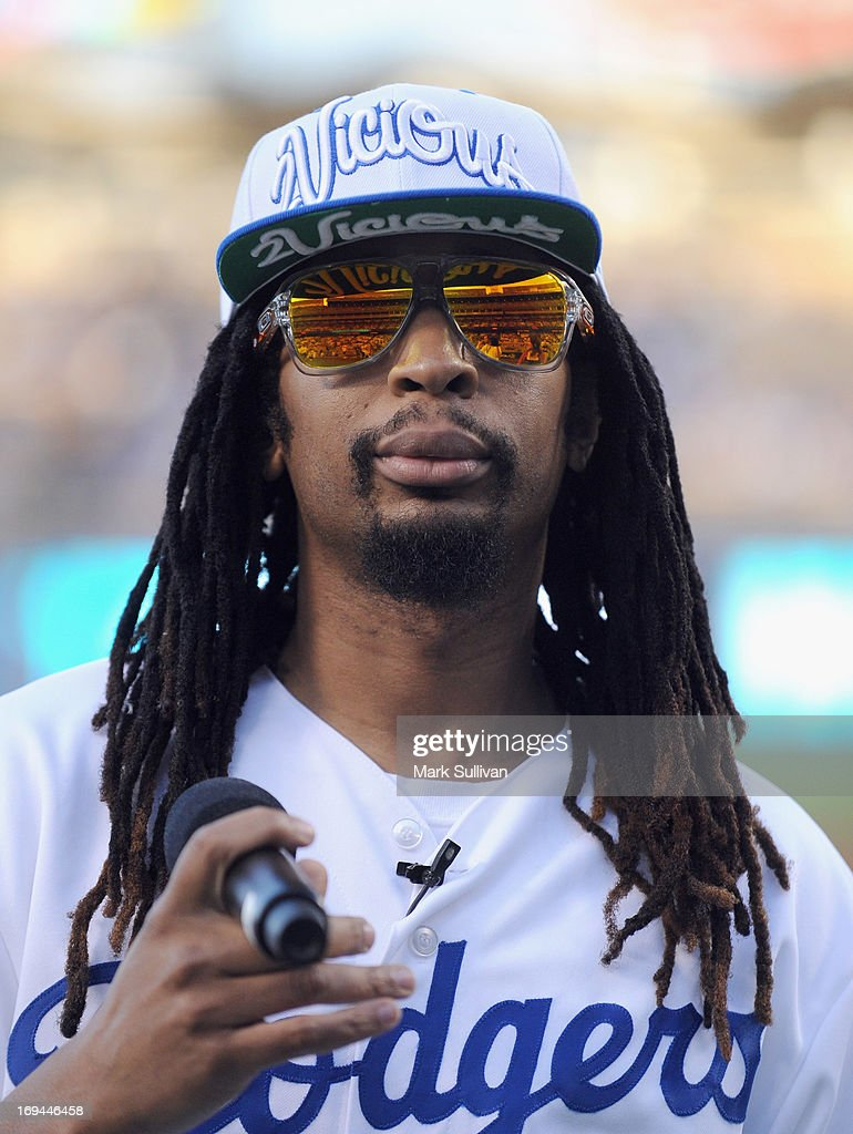 Rapper Lil Jon on the field before reading the Dodger starting lineup for the game between the St. Louis Cardinals and the Los Angeles Dodgers at Dodger Stadium on May 24, 2013 in Los Angeles, California.