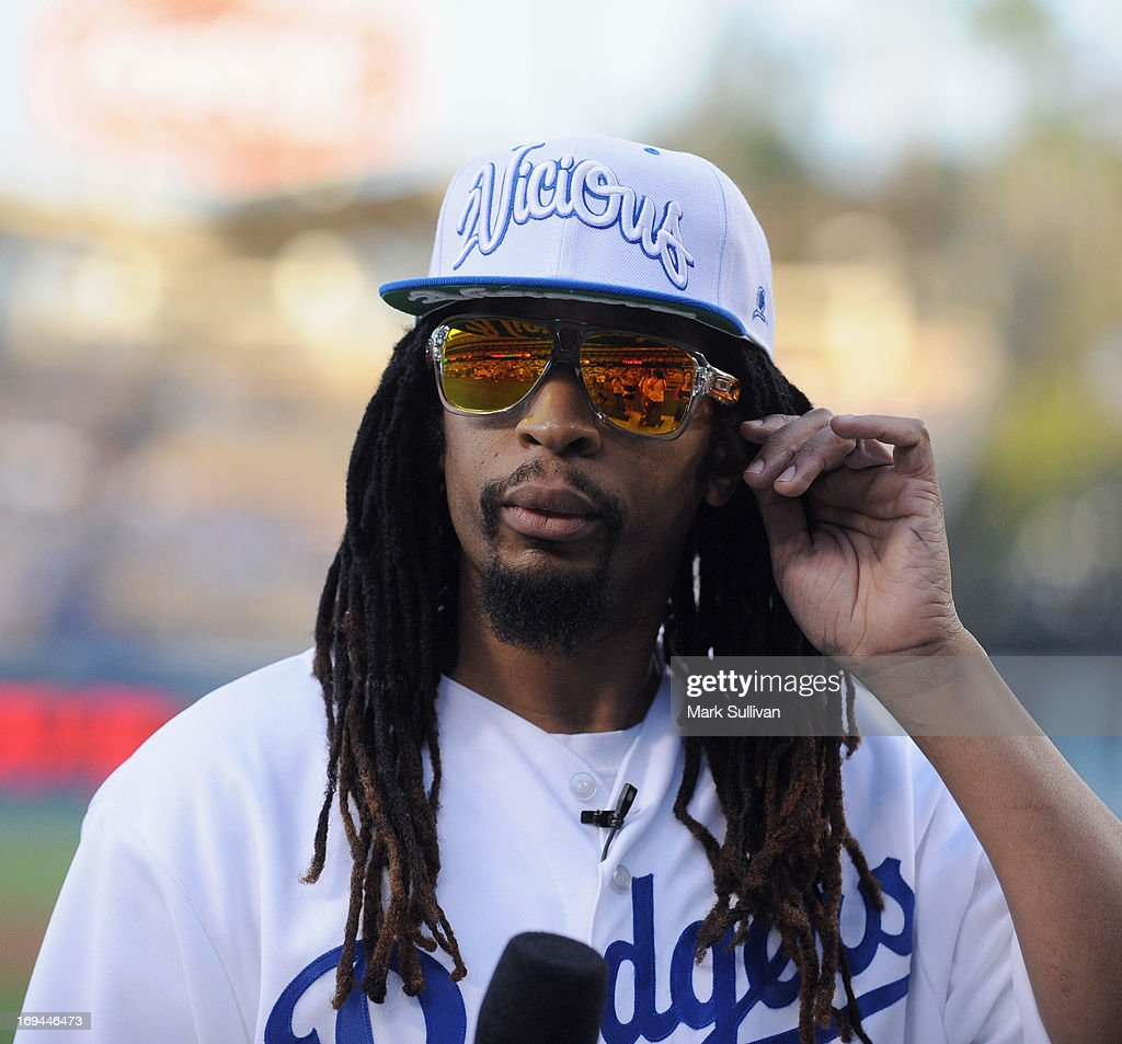 Rapper <a gi-track='captionPersonalityLinkClicked' href=/galleries/search?phrase=Lil+Jon+-+Rapero&family=editorial&specificpeople=202659 ng-click='$event.stopPropagation()'>Lil Jon</a> on the field before reading the Dodger starting lineup for the game between the St. Louis Cardinals and the Los Angeles Dodgers at Dodger Stadium on May 24, 2013 in Los Angeles, California.