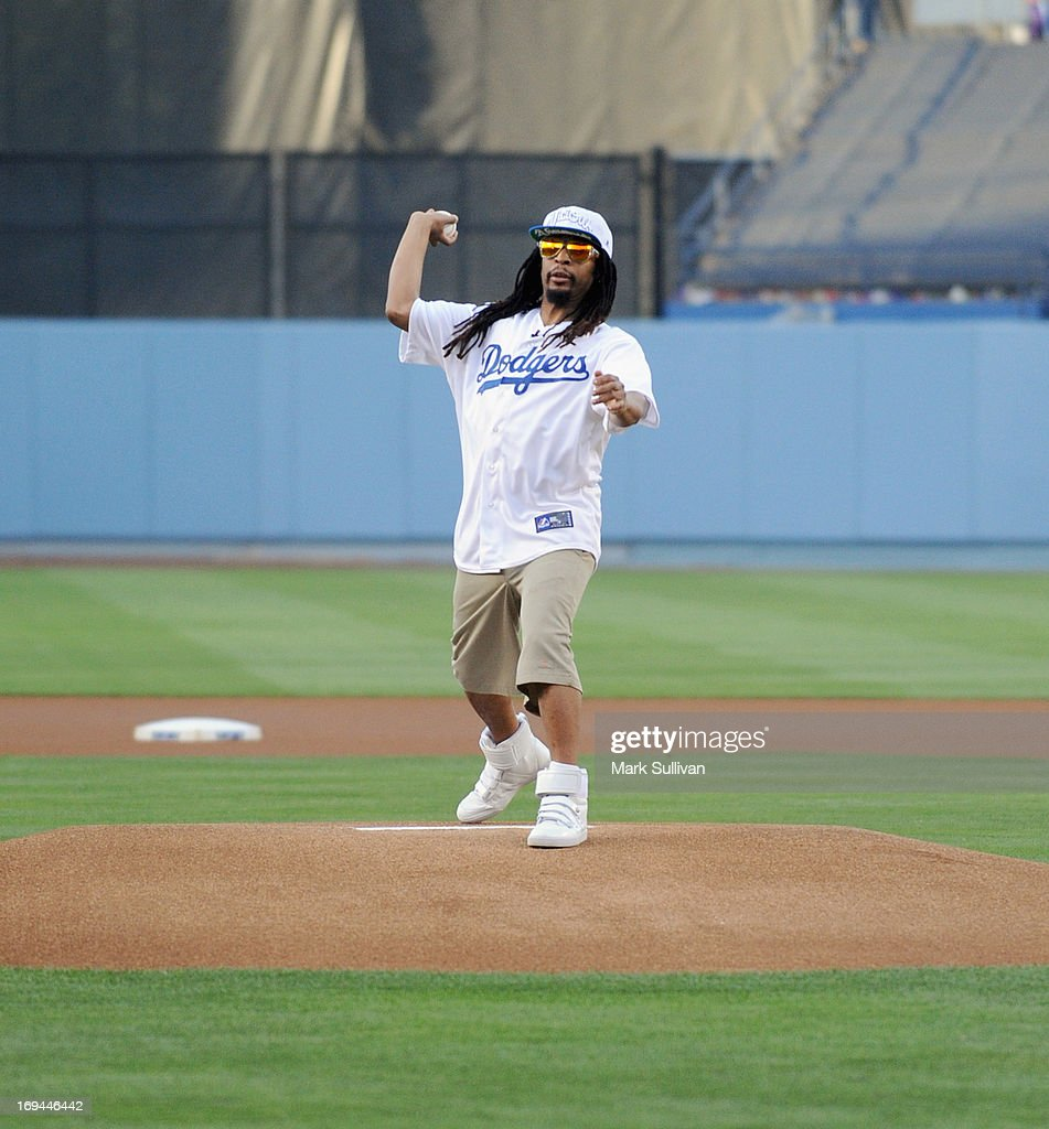 Rapper Lil Jon throws out the ceremonial first pitch before the game between the St. Louis Cardinals and the Los Angeles Dodgers at Dodger Stadium on May 24, 2013 in Los Angeles, California.