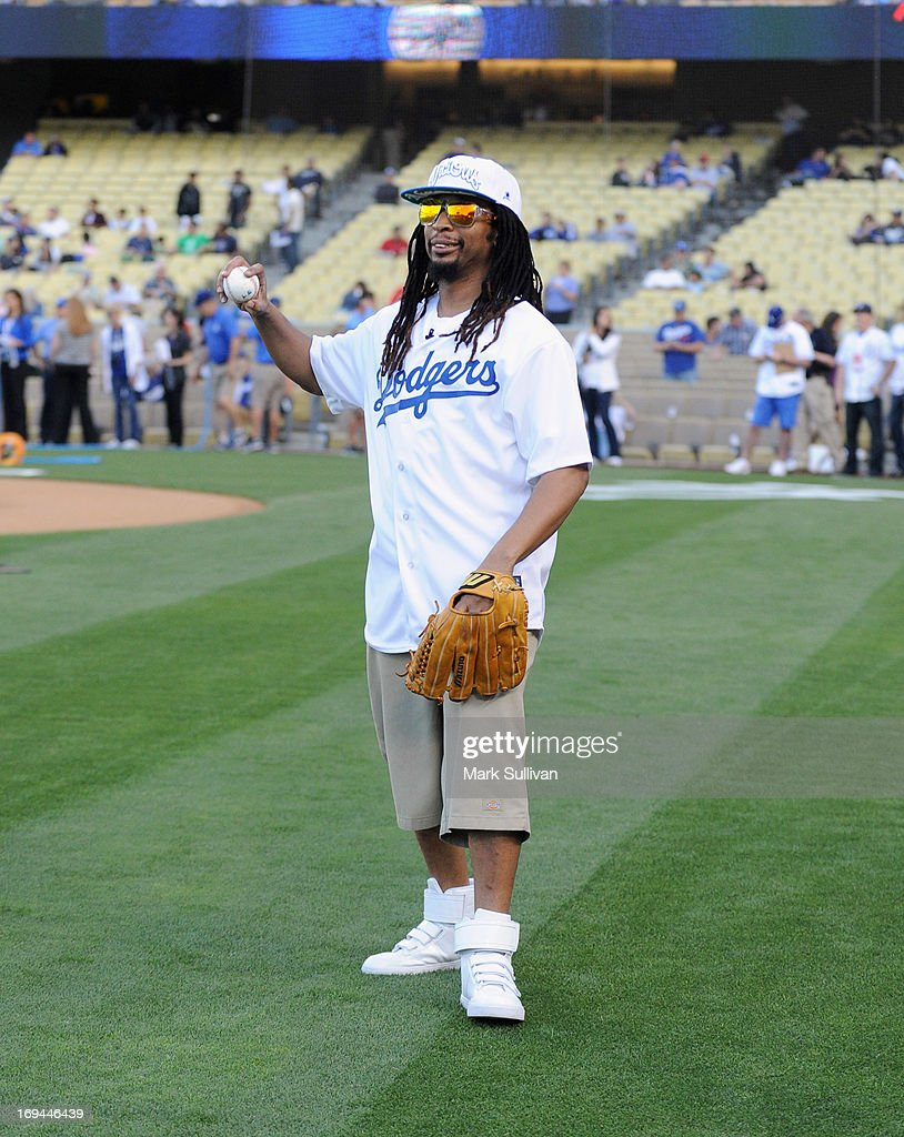 Rapper Lil Jon warms up before throwing out the ceremonial first pitch before the game between the St. Louis Cardinals and the Los Angeles Dodgers at Dodger Stadium on May 24, 2013 in Los Angeles, California.