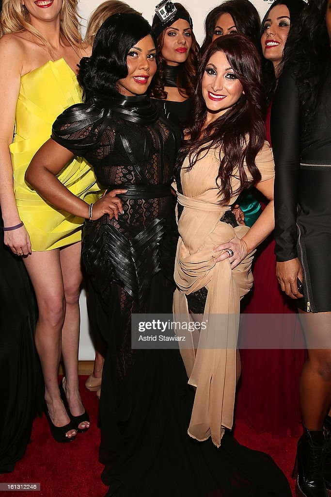 Rapper <a gi-track='captionPersonalityLinkClicked' href=/galleries/search?phrase=Lil%27+Kim&family=editorial&specificpeople=202942 ng-click='$event.stopPropagation()'>Lil' Kim</a> and Deena Cortese poses for photos backstage at the Reality of FASHION the Reality of AIDS fall 2013 fashion show during Mercedes-Benz Fashion Week at the Altman Building on February 9, 2013 in New York City.