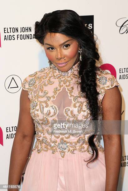 Rapper Lil' Kim attends the 23rd Annual Elton John AIDS Foundation's Oscar Viewing Party on February 22 2015 in West Hollywood California