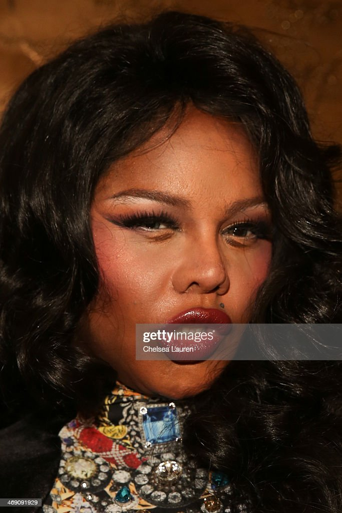 Rapper Lil' Kim backstage at the The Blonds fashion show during MADE Fashion Week Fall 2014 at Milk Studios on February 12, 2014 in New York City.
