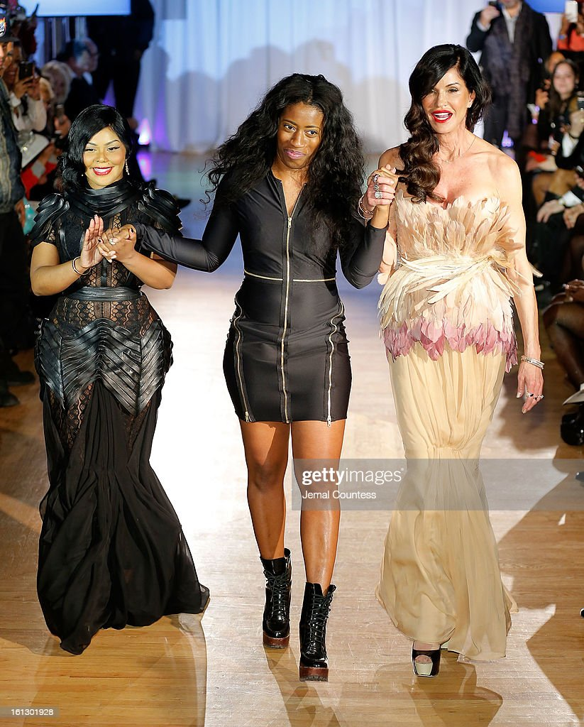 Rapper Lil Kim, designer Dominique Auxilly and model <a gi-track='captionPersonalityLinkClicked' href=/galleries/search?phrase=Janice+Dickinson&family=editorial&specificpeople=208845 ng-click='$event.stopPropagation()'>Janice Dickinson</a> walk the runway at the Reality of FASHION the Reality of AIDS fall 2013 fashion show during Mercedes-Benz Fashion Week>> at the Altman Building on February 9, 2013 in New York City.