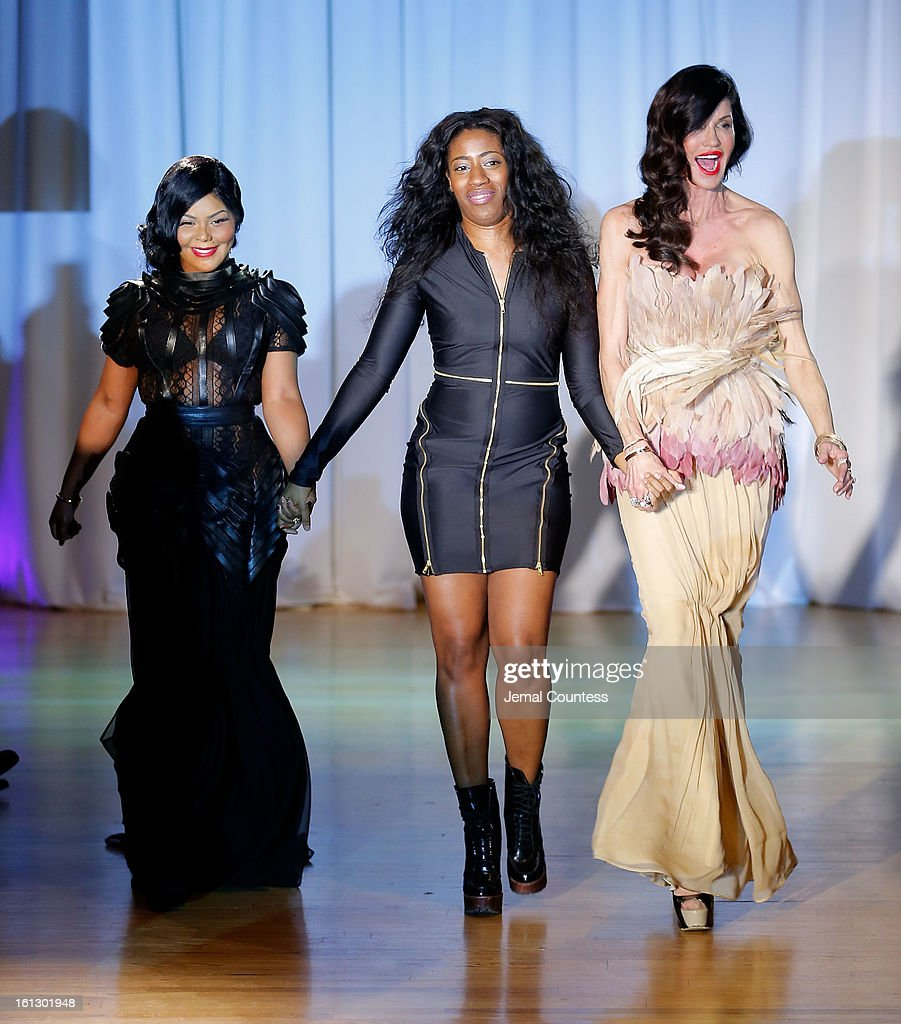 Rapper Lil Kim, designer Dominique Auxilly and model Janice Dickinson walk the runway at the Reality of FASHION the Reality of AIDS fall 2013 fashion show during Mercedes-Benz Fashion Week>> at the Altman Building on February 9, 2013 in New York City.