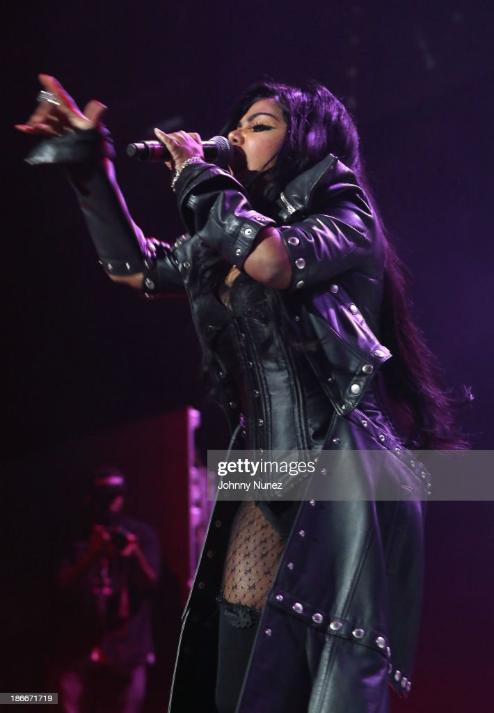 Rapper <a gi-track='captionPersonalityLinkClicked' href=/galleries/search?phrase=Lil%27+Kim&family=editorial&specificpeople=202942 ng-click='$event.stopPropagation()'>Lil' Kim</a> performs onstage at Power 105.1's Powerhouse 2013, presented by Play GIG-IT, at Barclays Center on November 2, 2013 in New York City.