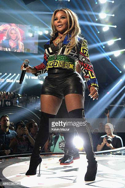 Rapper Lil' Kim performs onstage at the 2015 iHeartRadio Music Festival at MGM Grand Garden Arena on September 19 2015 in Las Vegas Nevada