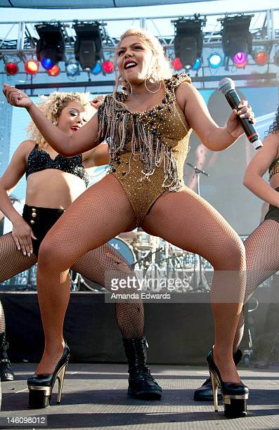 Rapper Lil' Kim performs onstage at the Los Angeles LGBT PRIDE Celebration on June 9 2012 in West Hollywood California