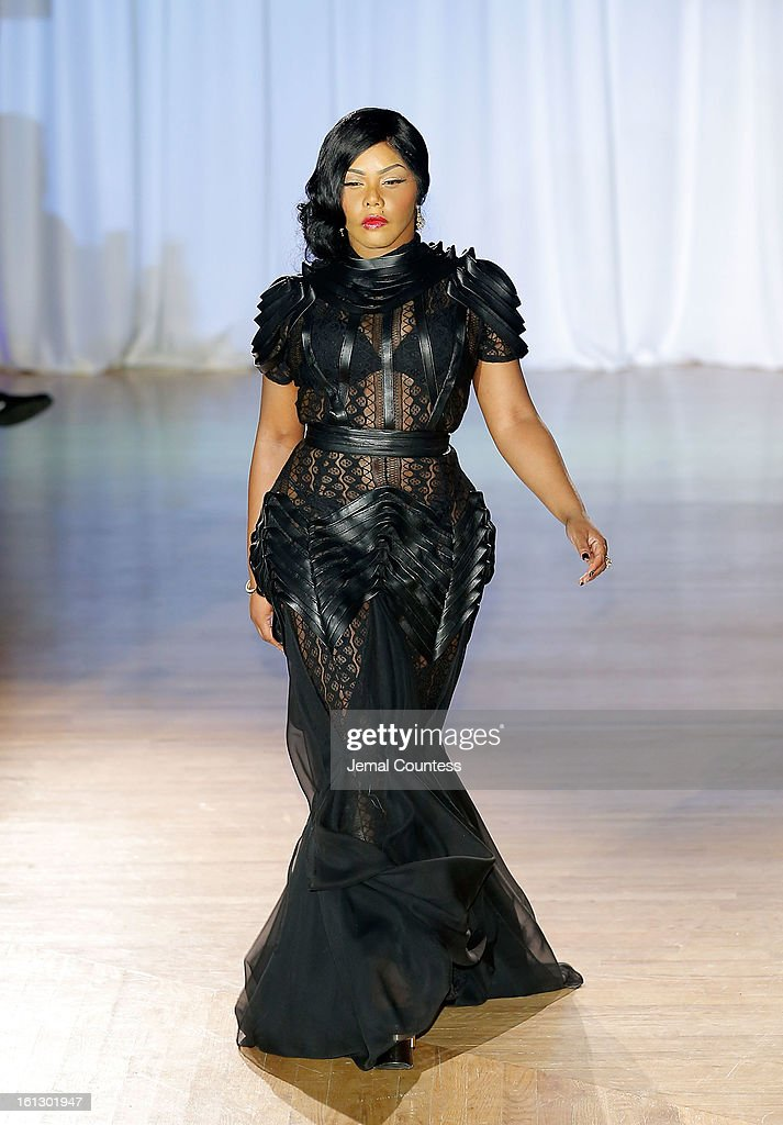 Rapper Lil Kim walks the runway at the Reality of FASHION the Reality of AIDS fall 2013 fashion show during Mercedes-Benz Fashion Week at the Altman Building on February 9, 2013 in New York City.