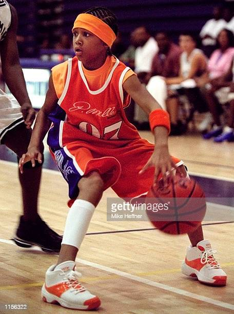 Rapper Lil' Romeo plays in a basketball game at the 2002 AAU National Boys 12 Under Basketball Championships July 15 2002 in Virginia Beach Virginia...
