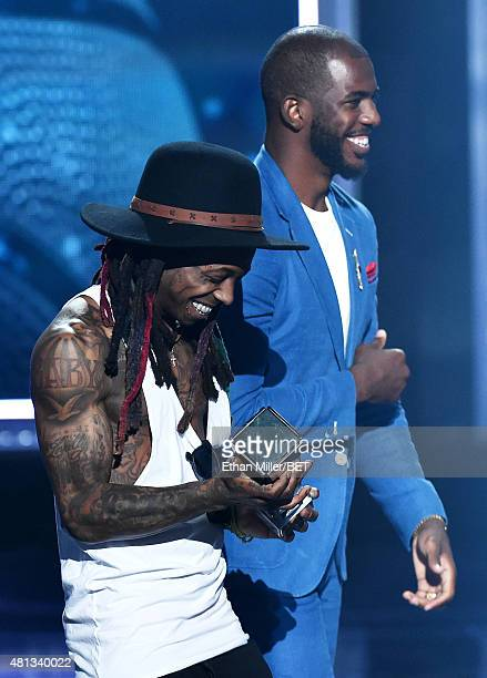 Rapper Lil' Wayne and NBA player Chris Paul of the Los Angeles Clippers speak onstage during The Players' Awards presented by BET at the Rio Hotel...